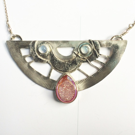 A druzy and moonstone commission pendant out of sterling silver...
